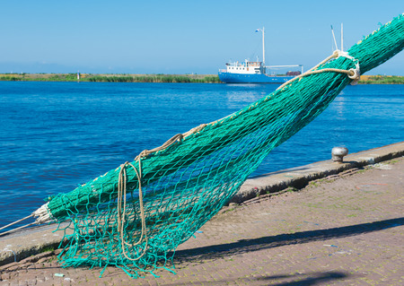 detail of a fishing net in a dutch harbor Stock Photo