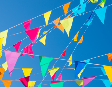 colorful bunting flags against a blue sky photo