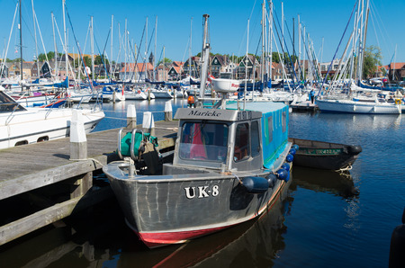 fishing fleet: old fishing boat with Urker registration number. Urk has by far the largest fishing fleet and fish processing industry in the Netherlands.