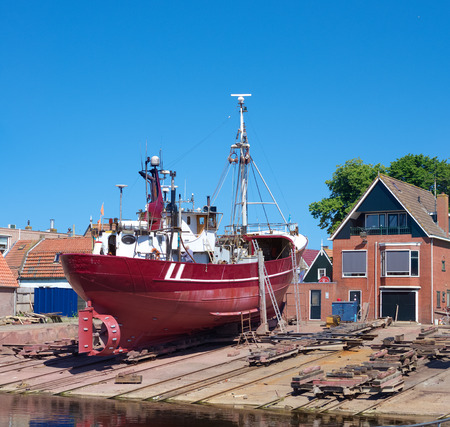 fishing fleet: fishing boat in dry dock in Urk, Netherlands. Urk has by far the largest fishing fleet and fish processing industry in the Netherlands. Editorial
