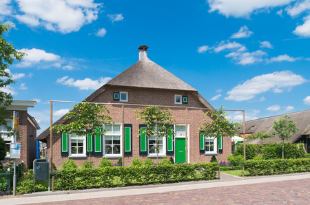 typically dutch: typically dutch farmhouse in staphorst. The community of Staphorst is known as one of the most religious in the Netherlands and has a very closed character Editorial