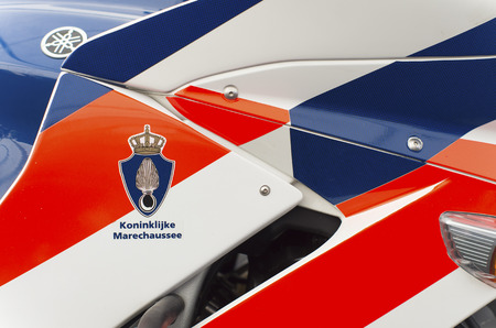 close up of a royal dutch police (marechaussee) motorbike at the Royal Dutch Air Force Days 2014 in Gilze-Rijen. It is one of the four services of the Dutch armed forces.