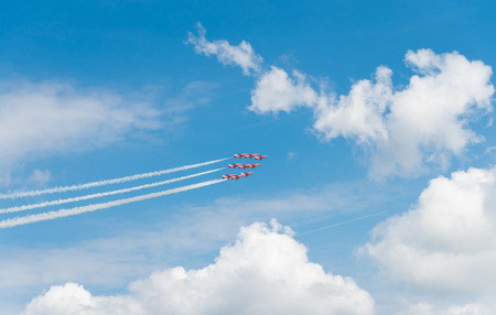 Royal Air Force stunt team red arrows in action on the Royal Dutch Air Force days 2014 in Gilze Rijen, Netherlands