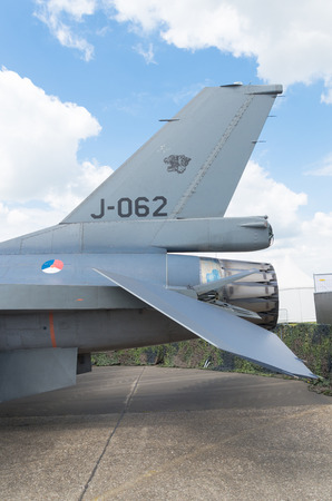 f 16: tail of a dutch f 16 fighter at the Royal Dutch Air Force open days 2014 in Gilze-Rijen, Netherlands