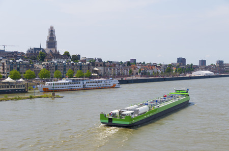 liquid natural gas powered tanker on the Waal river at Nijmegen, Netherlands. LNG Green Stream came into service in early 2013 as the first gasoil free tanker.