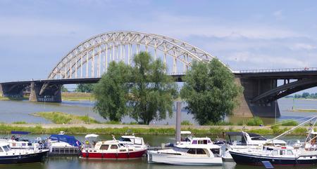 the Waal bridge crossing the Waal river at Nijmegen, netherlands photo