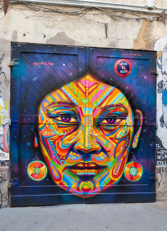 colorful face mural in berlin. The birth of Berlin