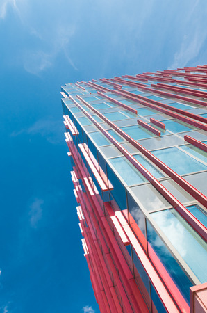 sky scraper: exterior of a modern office building in Almere, netherlands. It is the youngest and fastest growing city in the country, founded around 1975. Editorial