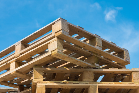 euro pallet: stacked up pallets against a blue sky