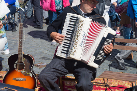 street artist playing his guerrini accordeon in the streets of zutphen, netherlands
