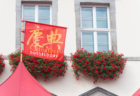 twinning: flag with chinese festival (chinafest) on it in dusseldorf, germany. This year, the State Capital Düsseldorf and the city of Chongqing in western China are celebrating the tenth anniversary of their twinning arrangement
