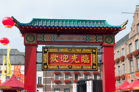 twinning: arch with chinese text in the streets of dusseldorf during the chinese festival (chinafest). This year, the State Capital Düsseldorf and the city of Chongqing in western China are celebrating the tenth anniversary of their twinning arrangement Editorial