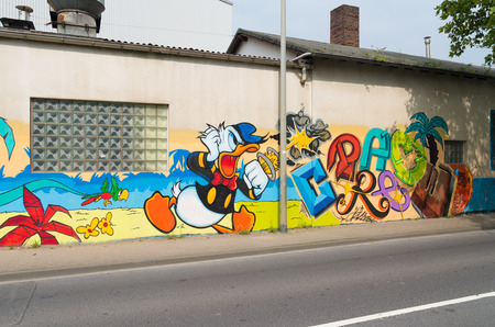 Graffiti Düsseldorf murial painting of donald duck on a wall in dusseldorf germany