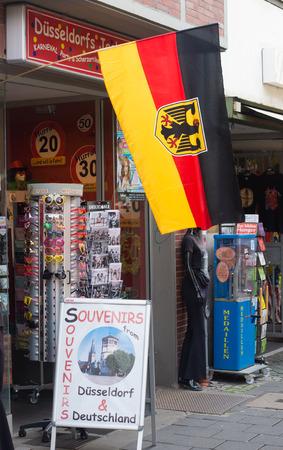 german flag: german flag in front of a souvenir shop in dusseldorf, germany Editorial