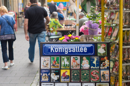 street name sign: konigsallee street name sign in dusseldorf, germany. Its famous for the fashion showrooms and luxury retail stores located along its sides.