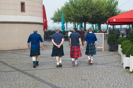 st patrics: men in traditional scottish kilts in the streets of dusseldorf, just a few days before the national referendum about scottish independancy