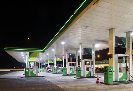 BP gas station at night. BP is a petroleum company with its headquarters in London. The company operates in around 80 countries