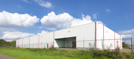 warehouse building: large white warehouse against a nice cloudy sky