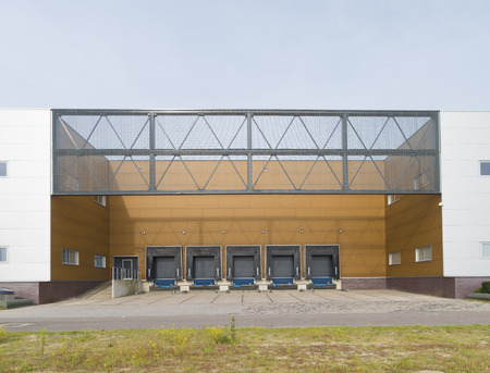 large distribution center with loading docks for trucks photo