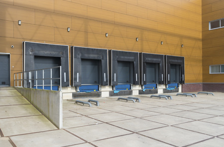 distribution center with loading docks for trucks photo