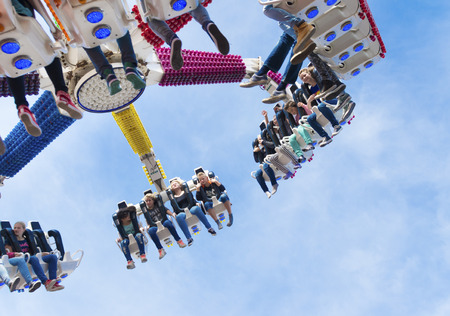 midway: adolescents enjoying their ride in a fair attraction