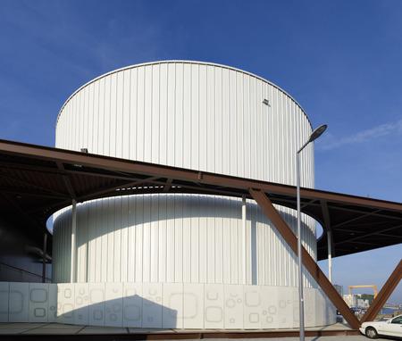 storage tank: large white storage tank in the rotterdam harbor