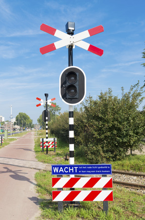 warning lights: railroad crossing sign with warning lights Stock Photo