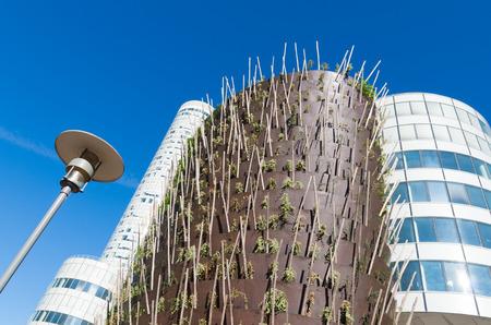 la defense: modern skyscraper planter filled with young plants and trees in La Defense, Paris Editorial