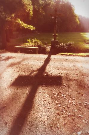 shafts: vintage filtered silhouette of a jesus cross in a rural landscape