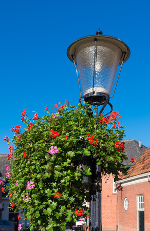street lantern: old street lantern surrounded by blooming flowers Stock Photo
