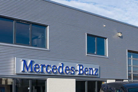 ag: exterior of a mercedes-benz truck dealer. Mercedes-Benz Trucks is now part of the Daimler Trucks division, and includes companies that were part of the DaimlerChrysler merger.
