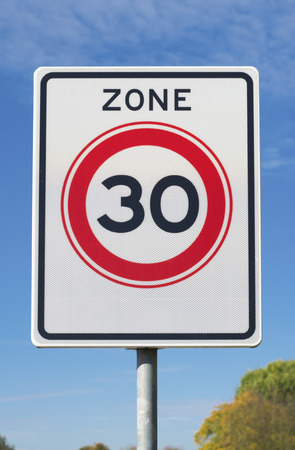 km: road sign with 30 km speed limit commandment