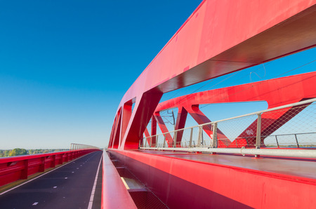 ijssel: bicycle lane along the new red railroad bridge over the IJssel river in the Netherlands Stock Photo