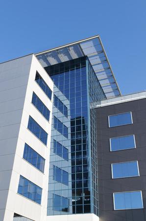 facade: exterior of a modern office building with glass facade