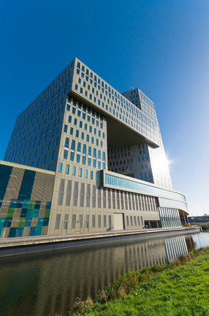 fense: dutch headquarters of GDF SUEZ in zwolle, netherlands. GDF SUEZ S.A. is a French multinational electric utility company, headquartered in La Défense, Paris, which operates in the fields of electricity generation and distribution, natural gas and renewabl Stock Photo