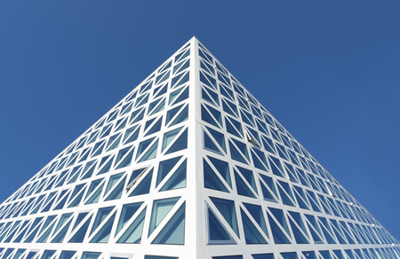 triangle shaped: detail of a modern building facade with triangle shaped windows