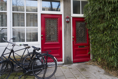 double red door in the center of amsterdam Stock Photo