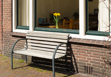 window bench: small bench in front of a window