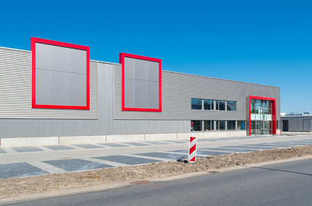 warehouse building: newly build modern red office building with warehouse Editorial
