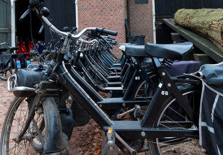 abbreviated: DENEKAMP, NETHERLANDS - NOVEMBER 15, 2014: Row of vintage Solex mopeds for hire. The mopeds were produced between 1946 and 1988 (abbreviated in the Netherlands to Solex) under the name Vélosolex, also the company name.