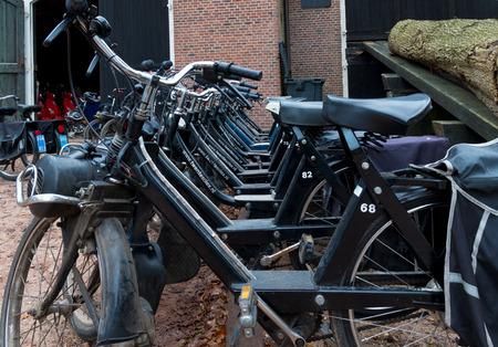 abbreviated: DENEKAMP, PAESI BASSI - 15 NOV 2014: Fila di ciclomotori d'epoca Solex noleggio. I ciclomotori sono stati prodotti tra il 1946 e il 1988 (abbreviato in Olanda per Solex) sotto il nome di VELOSOLEX, anche il nome della societ�.