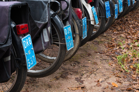 abbreviated: DENEKAMP, NETHERLANDS - NOVEMBER 15, 2014: Vintage Solex mopeds for hire. The mopeds were produced between 1946 and 1988 (abbreviated in the Netherlands to Solex) under the name Vélosolex, also the company name.