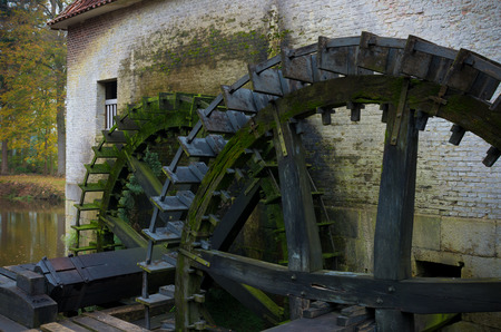 watermill: wooden wheels of an ancient watermill Stock Photo
