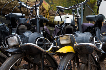 DENEKAMP, NETHERLANDS - NOVEMBER 15, 2014: Vintage Solex mopeds for hire. The mopeds were produced between 1946 and 1988 (abbreviated in the Netherlands to Solex) under the name Vélosolex, also the company name.