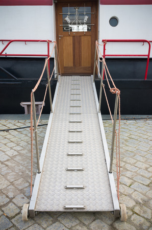 gangway: metal gangway between quay and ship
