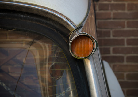 tail light: DEVENTER, NETHERLANDS - NOVEMBER 29, 2014: Typical tail light of a citroen ds. The DS was presented on October 6, 1955 at the Paris Motor Show and hit like a bomb Editorial
