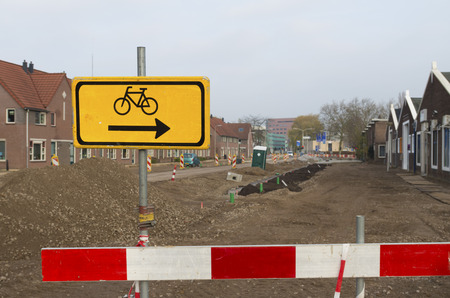 redirection: road work with a detour sign for cyclists