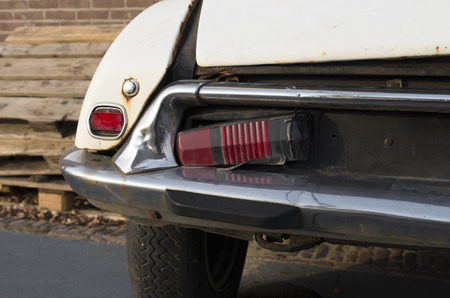tail light: DEVENTER, NETHERLANDS - NOVEMBER 29, 2014: Broken tail light of a citroen ds. The DS was presented on October 6, 1955 at the Paris Motor Show and hit like a bomb Editorial