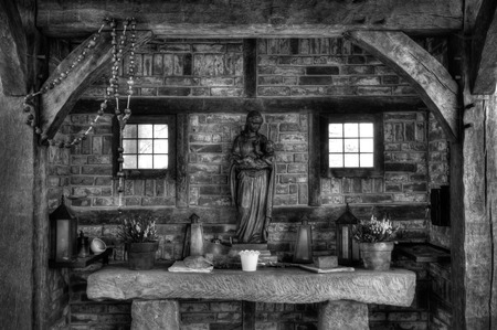 jesus statue: interior of a small chapel with mary with jesus statue