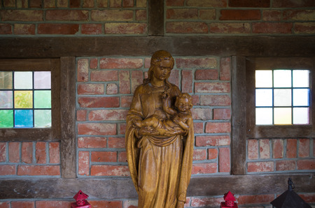 mother of jesus: wooden statue of virgin mary with jesus child in her arms